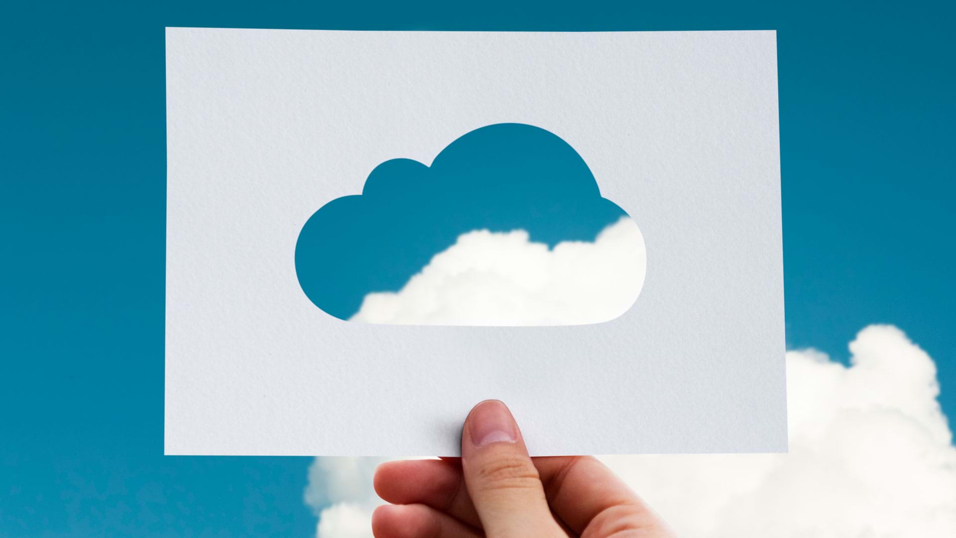 Hand holding Cloud Paper Cutout